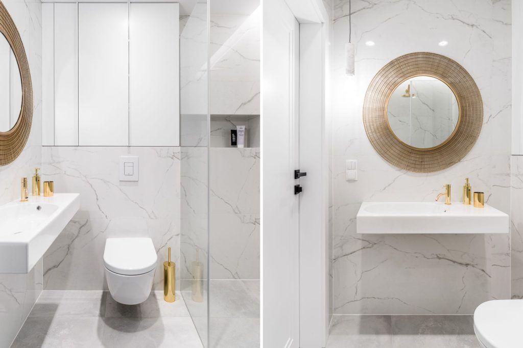 marmurowa łazienka ze złotym lustrem