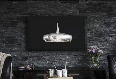 Dekoracyjne oświetlenie ściany z kamienia – na jakie lampy postawić?
