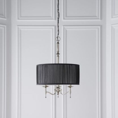 srebrna lampa z czarnym abażurem