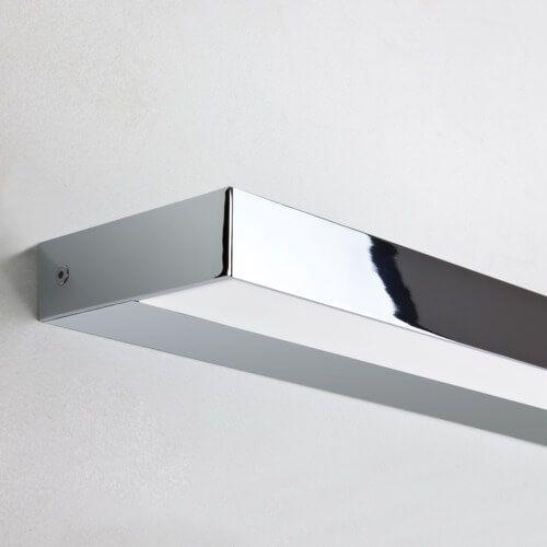 designerski, minimalistyczny kinkiet w srebrnym połysku