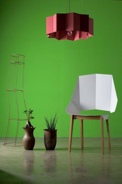 różowa lampa na zielonym tle - neonowe wnętrze