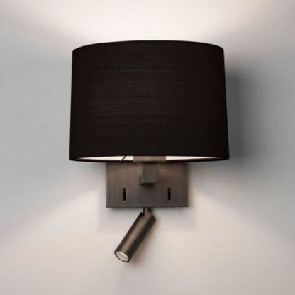 brązowy kinkiet z czarnym abażurem i dodatkowym, nowoczesnym reflektorem do czytania
