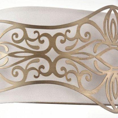 biały kinkiet ze złotymi detalami