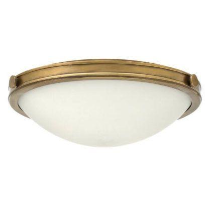 szklana lampa sufitowa w złotej ramie