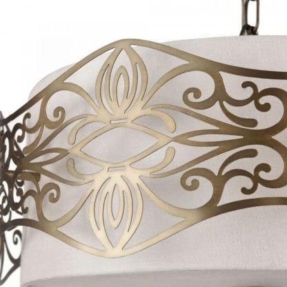 okrągła lampa wisząca z białym abażurem ozdobionym złotym wzorem wycinanym laserowo w metalu