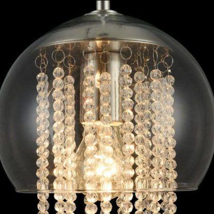 transparentna, szklana lampa wisząca z kryształkami i metalowymi listkami dekoracyjnymi