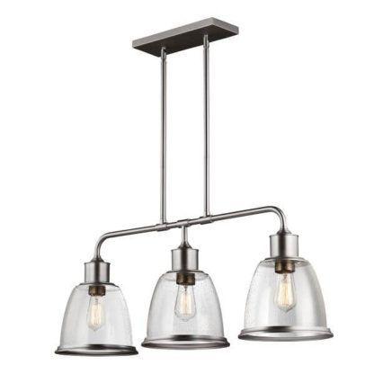 industrialna lampa wisząca z trzema bezbarwnymi kloszami ze szkła