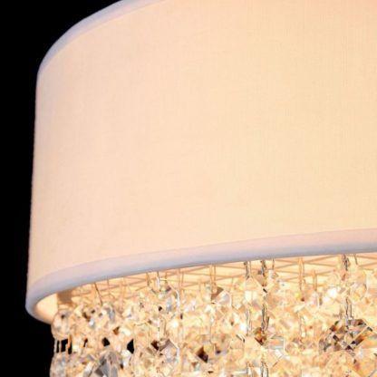 lampa wisząca z białym abażurem i kryształkami