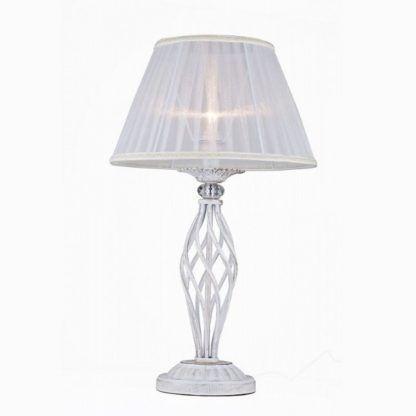 biała lampa stołowa z ażurową podstawą z metalu