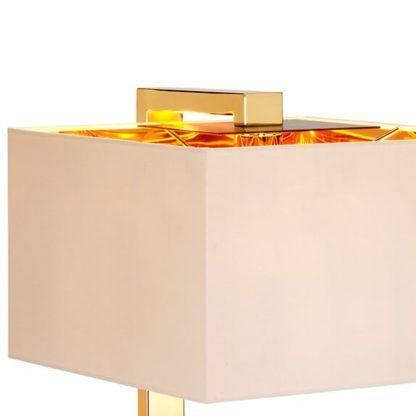 nowoczesna lampa stołowa z jasnym abażurem złotym w środku