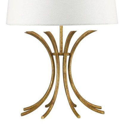 metalowa lampa stołowa z ażurową podstawą w złotym kolorze