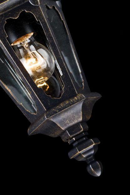 brązowa lampa wisząca ze szklanym kloszem, oświetlenie na zewnątrz