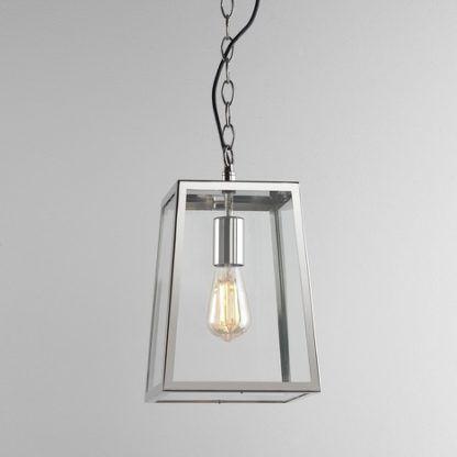 lampa wisząca ze szklanym kloszem w srebrnej oprawie