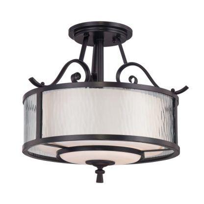 ciemna lampa sufitowa z jasnym szklanym kloszem