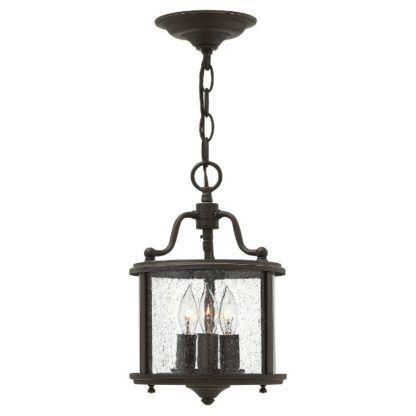 brązowa lampa wisząca świecznik ze szklanym kloszem