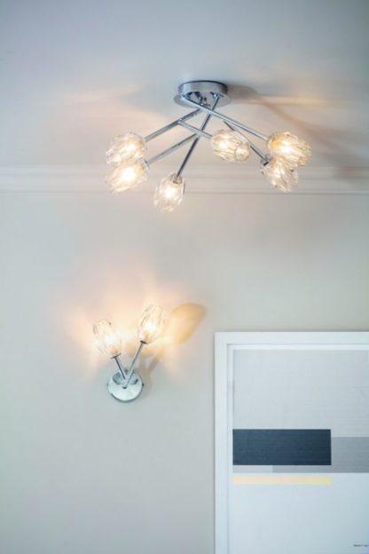 srebrne lampy ze szklanymi kloszami