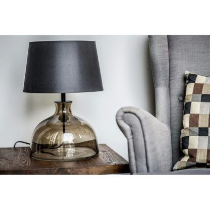 bezowa lampa stołowa z czarnym abażurem