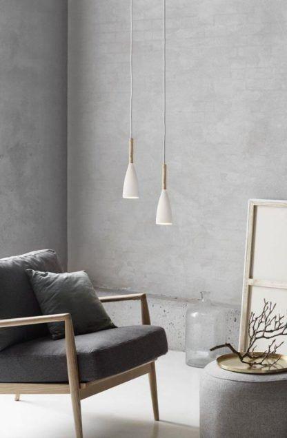 biała lampa wisząca na betonowej ścianie