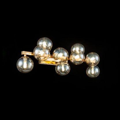 złoty kinkiet z bursztynowymi kulami