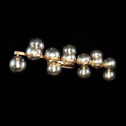 szklany złoty kinkiet do nowoczesnego salonu