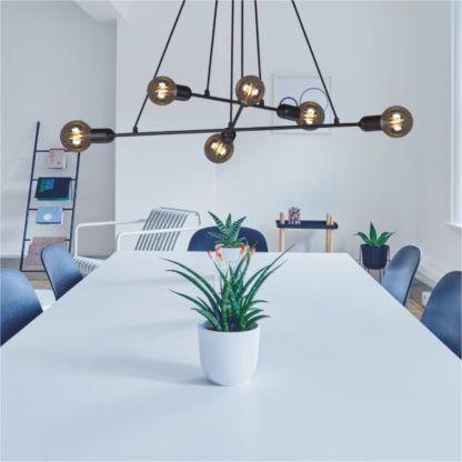 duża lampa wisząca nad stół czarne pręty