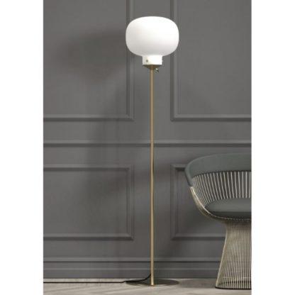 złota lampa podłogowa z białym kloszem