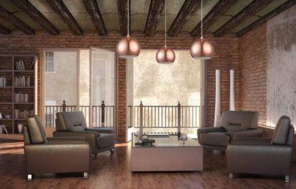 miedziane lampy w salonie industrialnym