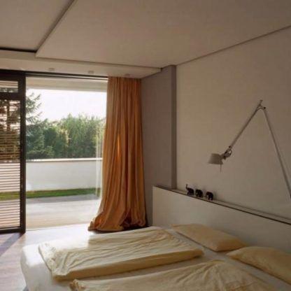 nowoczesny kinkiet do sypialni