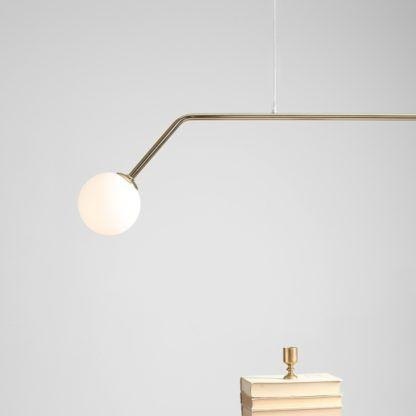 złota nowoczesna lampa wisząca