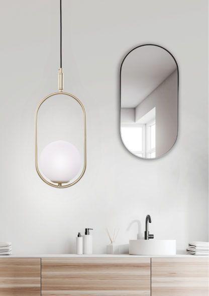 nowoczesna lampa wisząca szklany klosz złota ramka aranżacja