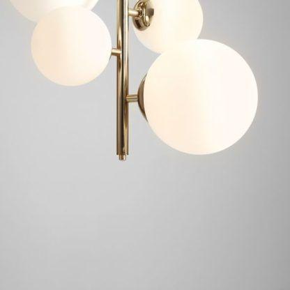 złota lampa wisząca pion szklane klosze