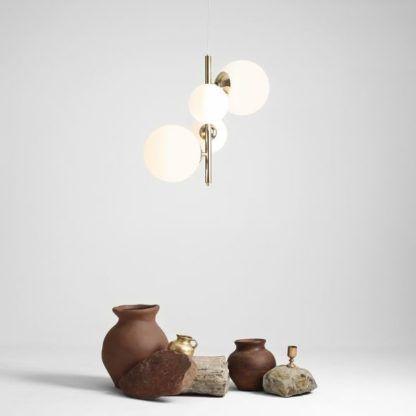 złota lampa wisząca szklane kule pion