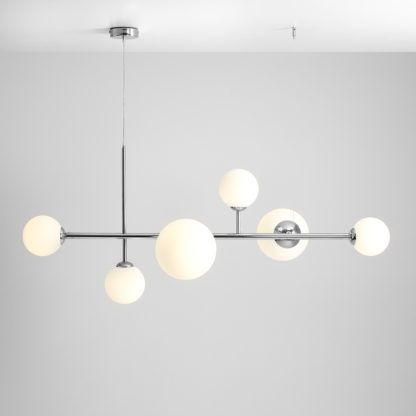 srebrna podłużna lampa wisząca nad stół