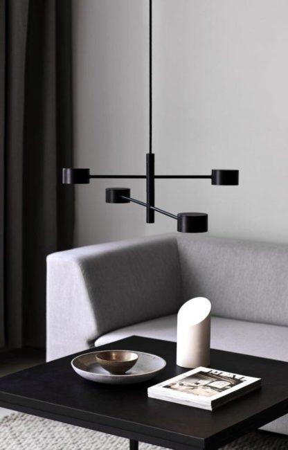 czarna lampa wisząca led nad stół aranżacja