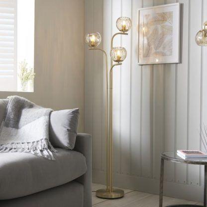 złota lampa podłogowa bursztynowe klosze do salonu