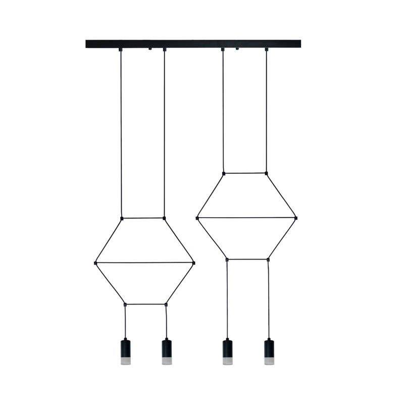 czarna designerska lampa wisząca nad stół