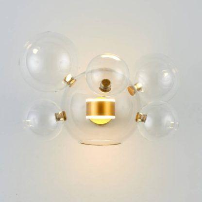 złoty kinkiet ze szklanymi bańkami nowoczesny