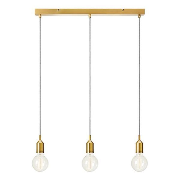 podłużna złota lampa wisząca nad stół