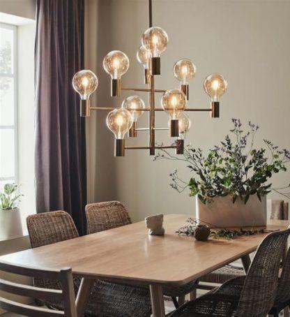 złoty żyrandol nad stół styl loft