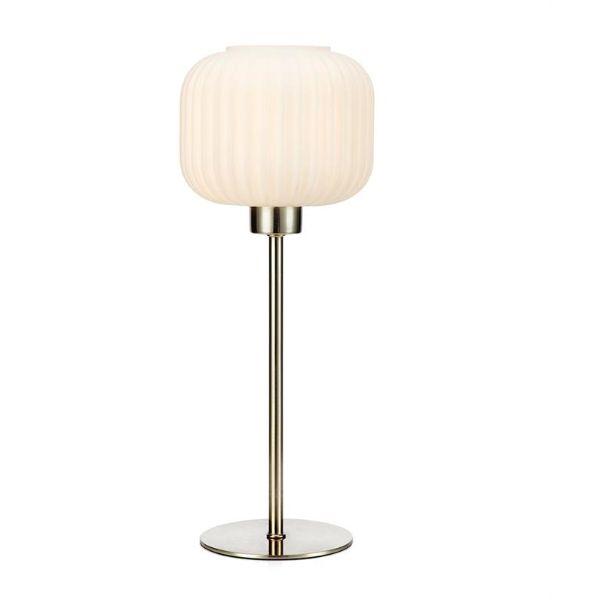 srebrna lampa stołowa na cienkiej nóżce