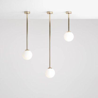 złote lampy do salonu różne wysokości