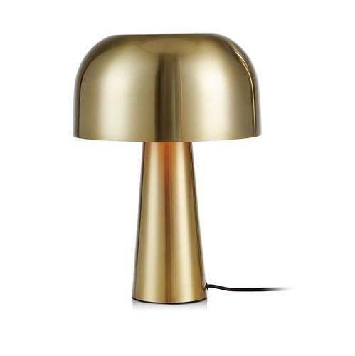 złota lampa stołowa na parapecie
