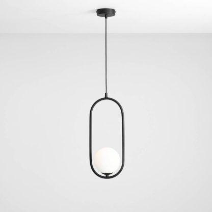 czarna owalna lampa z białą kulą