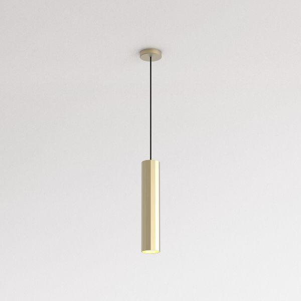 złota wąska lampa wisząca nad stół