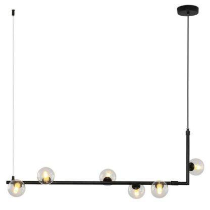 podłużna czarna lampa wisząca nad stół