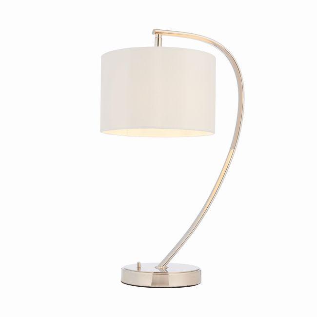 lampa stołowa z zaokrągloną, srebrną podstawą i beżowym abażurem - aranżacja