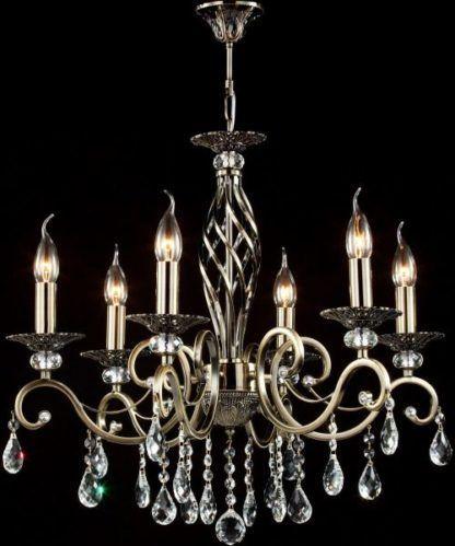 złoty żyrandol z żarówkami w kształcie świec z kryształami