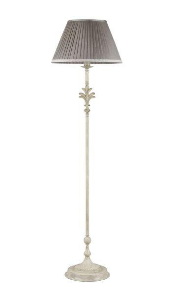 lampa podłogowa przy czarnej ścianie z abażurem