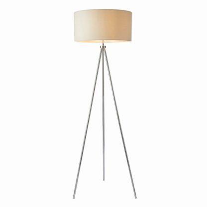 lampa podłogowa na trzech srebrnych nogach, beżowy klosz, styl nowoczesny