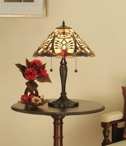 mała szklana lampa w kolorze brązowym i beżowym